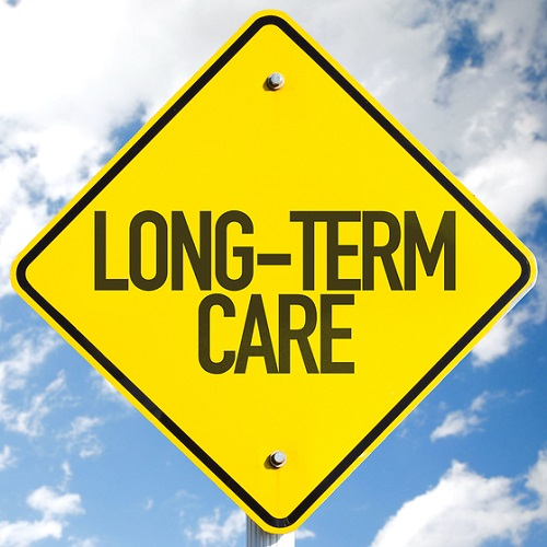 Long-Term Care sign with sky background.